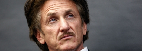U.S. actor Sean Penn listens to former Soviet leader President Mikhail Gorbachev (not pictured) speak to students at the Frederick Von Steuben Metropolitan Science Center in Chicago, Illinois April 23, 2012. REUTERS/Jeff Haynes (UNITED STATES - Tags: ENTERTAINMENT POLITICS HEADSHOT)